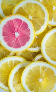 A pink lemon-slice among yellow slices.